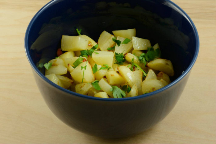 Ethiopian potato salad in a blue bowl