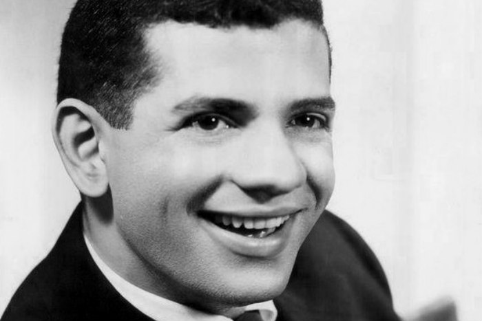 Black and white image of a young and smiling TV star Robert Clary