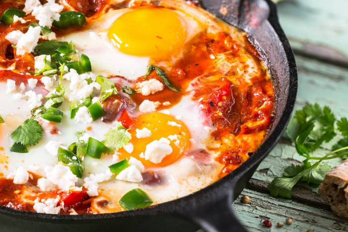 Mexican Shakshuka in a cast iron pan topped with cilantro