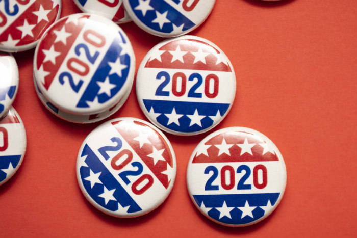 2020 buttons in red white and blue scattered over a red background