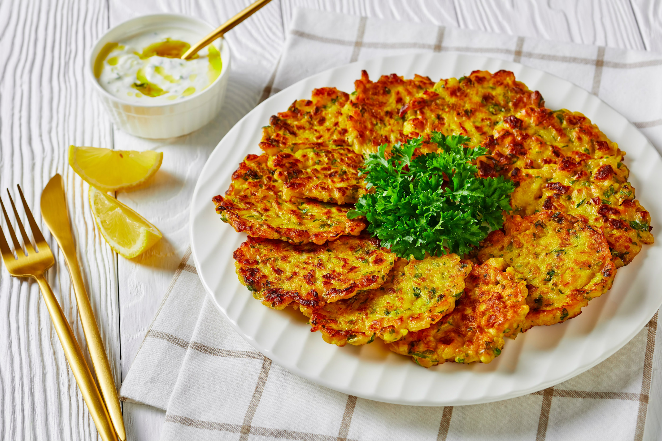 Plate of leek patties on a tablescape