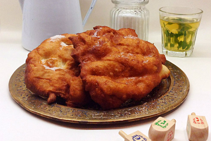 Large mound of fried dough on a platter