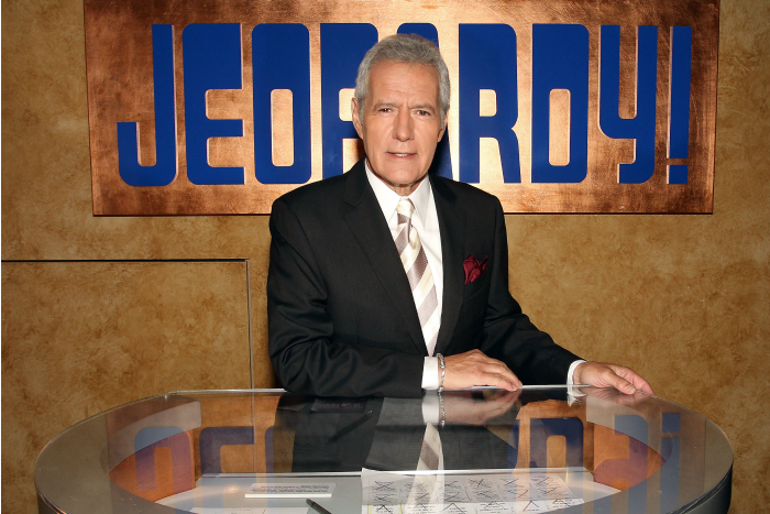 Alex Trebek poses on Jeopardy set
