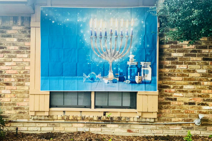 Hanukkah sign on the side of a house