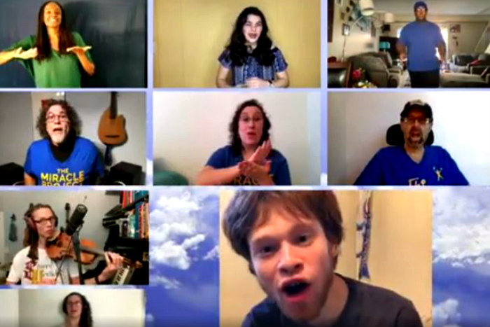 Screenshot from of One Breath music video depicting various people singing on a Zoom screen