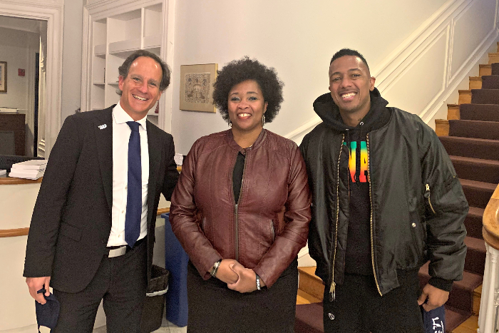 Rabbi Jonah Pesner and Yolanda Savage Narva pose with Nick Cannon in the foyer of the RAC building