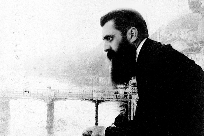 Black and white image of Theodor Herzl leaning over the balcony of a conference center in Switzerland