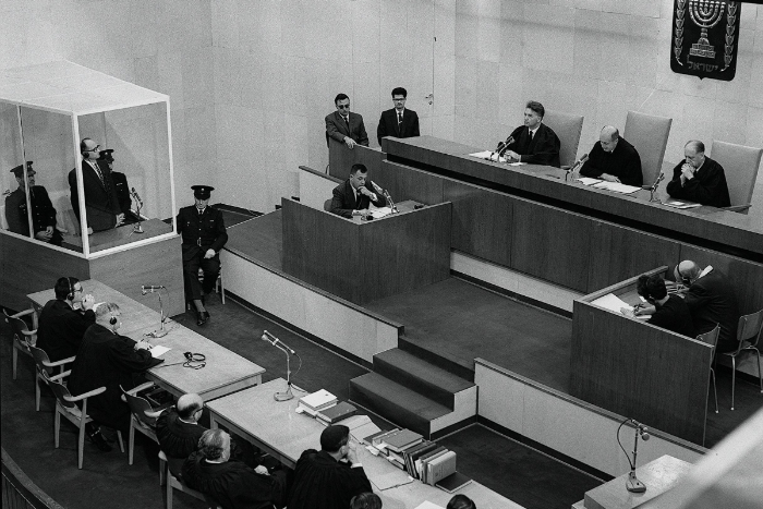 Black and white image of the courtroom during the Eichmann trial