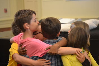 A group of second graders say goodbye during a Yom Kippur activity for the Jewish High Holidays