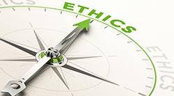 Compass needle pointing to the word Ethics