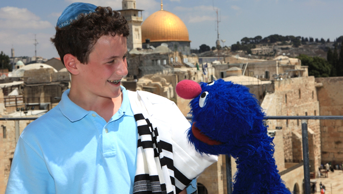 A blue monster named Grover and boy in Israel
