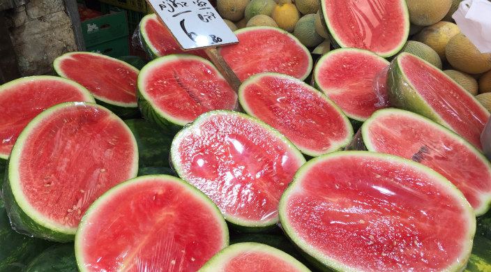Watermelon halves on display in Israeli market