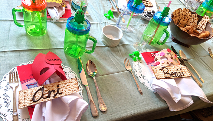 Passover seder table with child-friendly objects