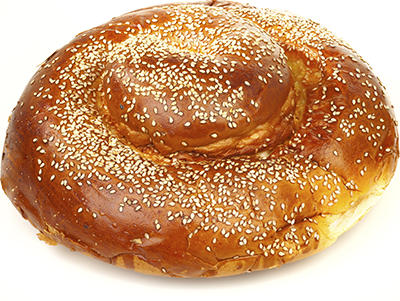 Round challah with sesame seeds on top