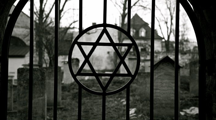 Star of David on wrought iron gate leading to old cemetery