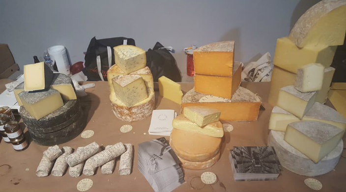A variety of cheeses spread out on a table