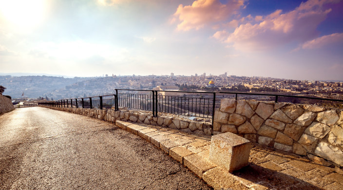 Empty stone street overlooking Jerusalem at sunset