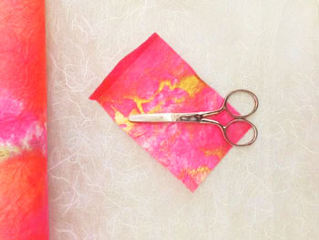 Scissors and a sheet of paper for a Passover Activity