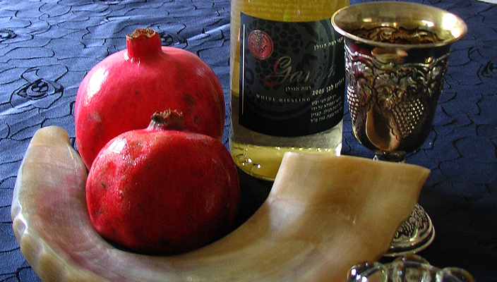 Kiddush cup, wine, and a Shofar, ritual objects for the Jewish holiday of Rosh HaShanah