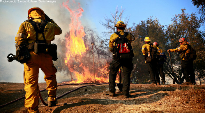 Three firefighters face the California wildfires