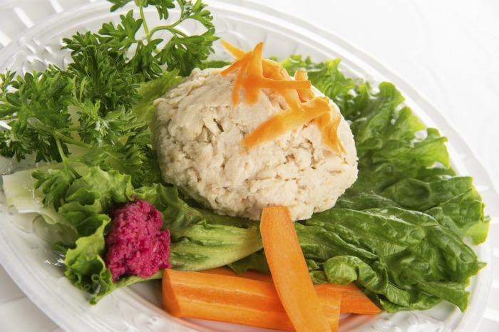 plated gefilte fish with horseradish