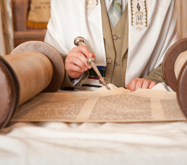 Boy reading from the Torah for his Bar Mitzvah