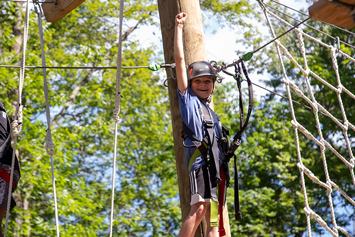 camper enjoying the ropes course at URJ Crane Lake Camp