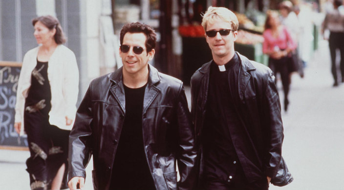 Ben Stiller and Edward Norton walking down the street dressed in leather
