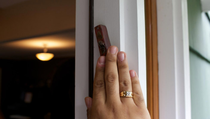 Hand touching a mezuzah