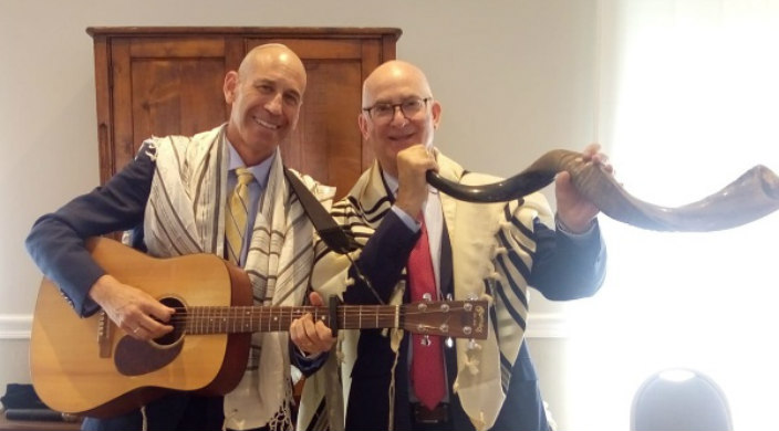The author (holding guitar) and his husband (with shofar) at High Holiday services in Milan