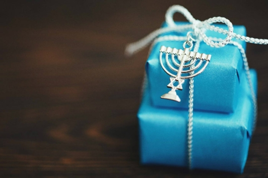 Stack gifts in blue wrapping paper with silver bows and a Star of David charm