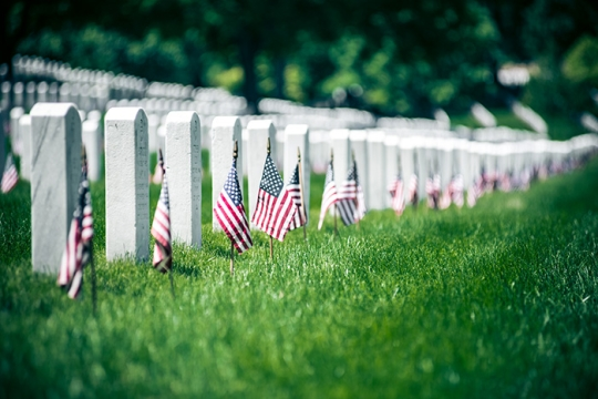 soldiers graves with American flags