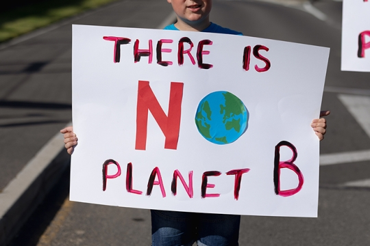 Person holding sign that says There is No Planet B
