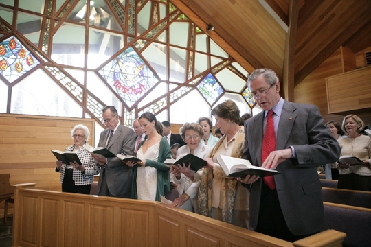 President George W. Bush and Mrs. Bush participate in an Easter service at the Evergreen Chapel at Camp David, Maryland, Sunday, April 16, 2006. Also pictured in front row, from right, are Jenna Welch, Barbara Bush, Former President George H. W. Bush and First Lady Barbara Bush.