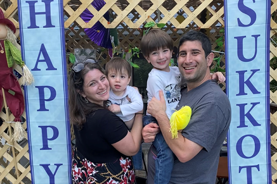 Cantor Lauren Phillips Fogelman and family in their sukkah