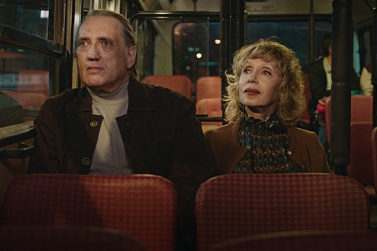 A scene from the film Golden Voices - VIctor and Raya on a bus