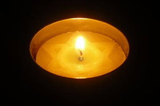 A candle to commemorate the victims of the Holocaust for Yom Hashoah