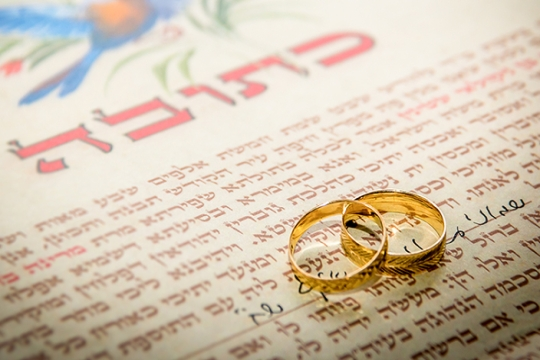 Ketubah, or wedding contract, with wedding bands