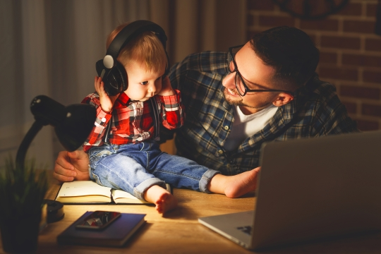 boy and father listening to music