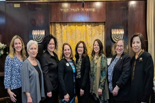 Reform Jewish women pose together in from of an ark while in Israel together during Rosh Chodesh