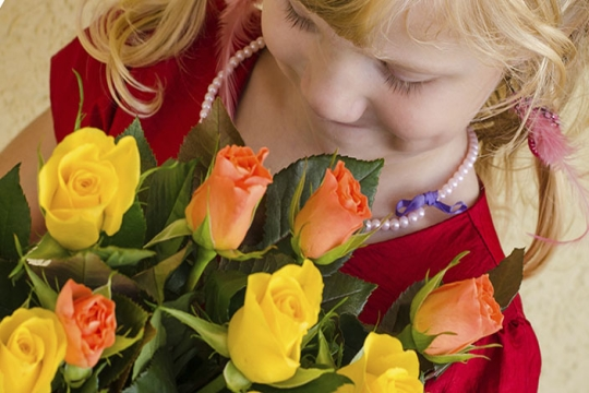 young girl giving bouquet of roses