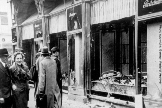 Black and white images of broken glass in a storefront after Kristallnacht