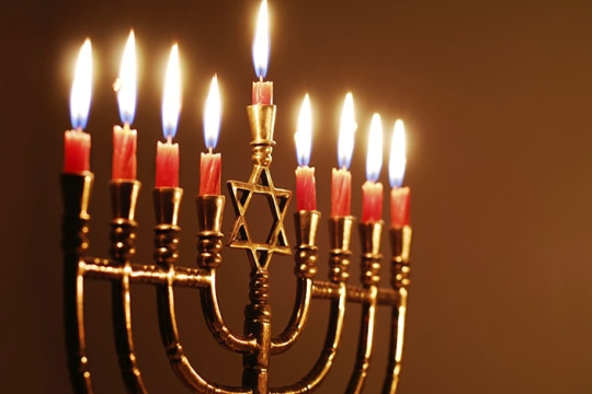 A menorah with all candles lit