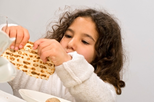 Preschooler doing a family activity for the Jewish holiday of Passover or Pesach