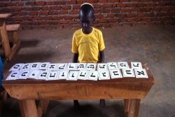 Ugandan Jewish child studying Hebrew alphabet