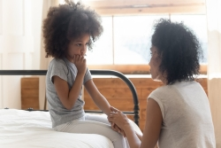 mother talking with child about COVID-19