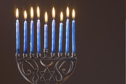 A menorah with candles for the Jewish holiday of Hanukkah
