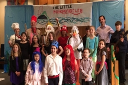 Group of children in costumes under a sign reading THE LITTLE MERMAIDELEH