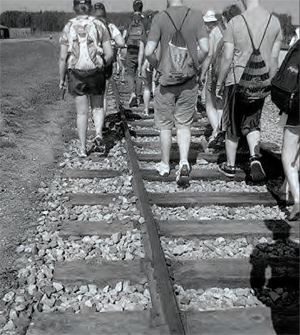 Walking on the tracks at Auschwitz-Birkenau. I'm in the middle wearing white sneakers. Photo by Sam Waldman.