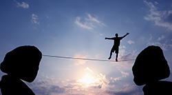 Man balancing on a high wire